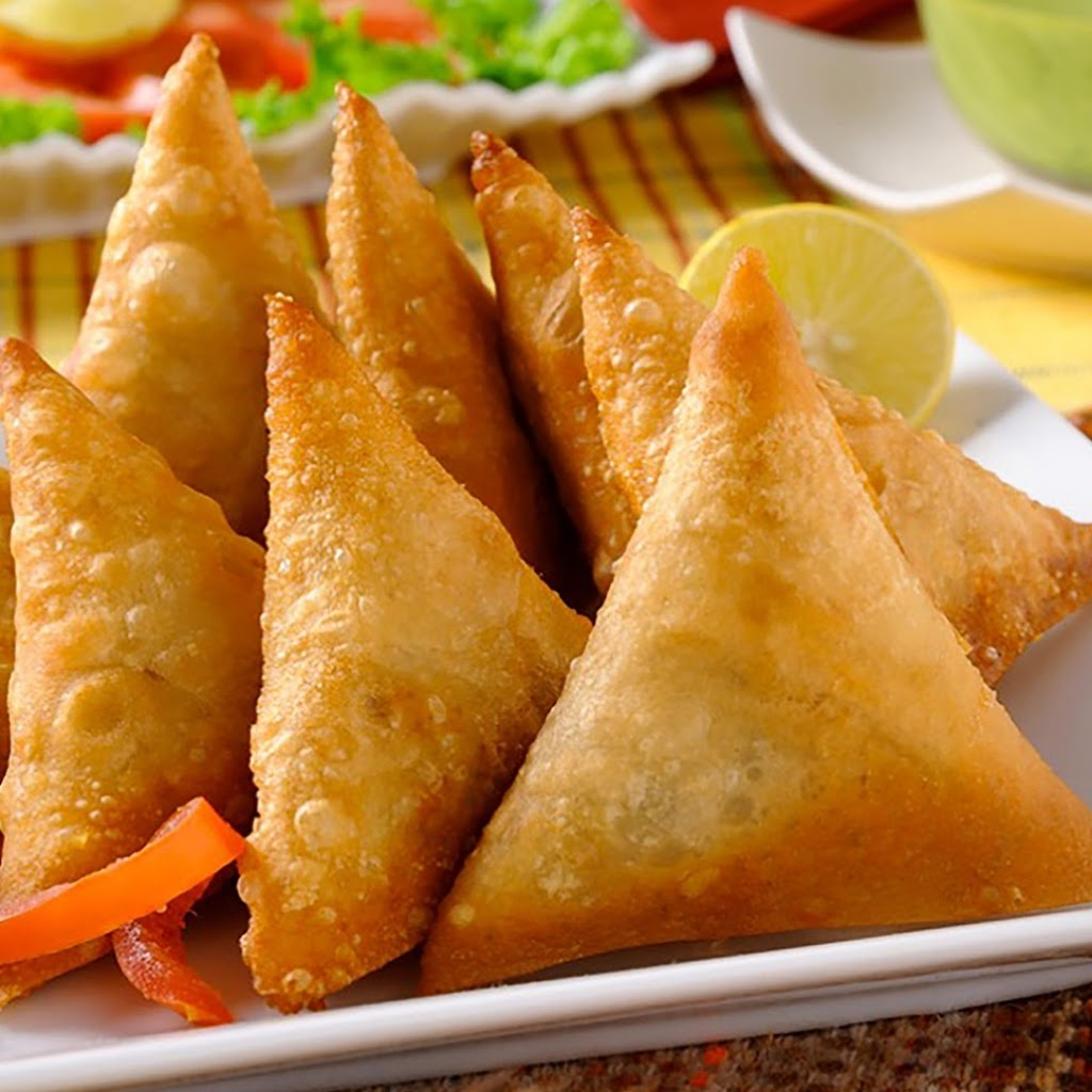Nile Cafe - Samosas, Jamaican beef patties and more  - Meal